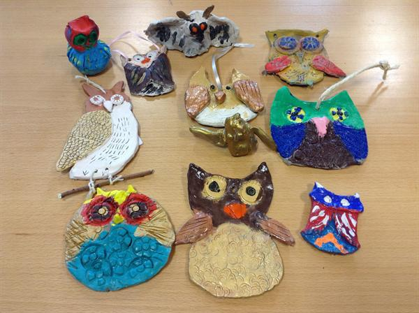 Clay owls made by the whole school!