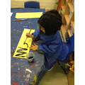 Painting car number plates.