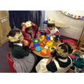 Having a birthday party in the role-play area.