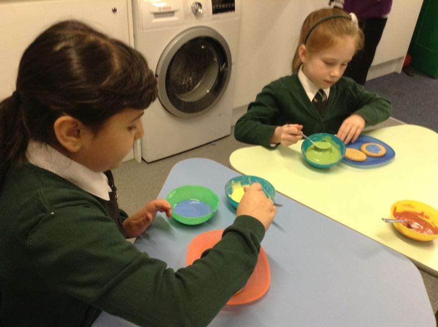 We are decorating biscuits to raise money.