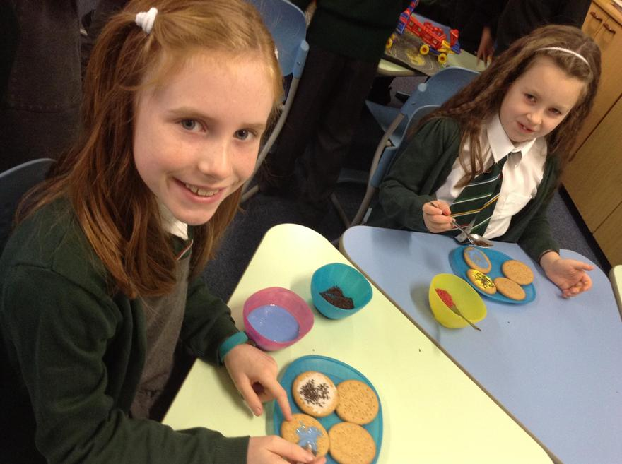 We are decorating biscuit to raise money.