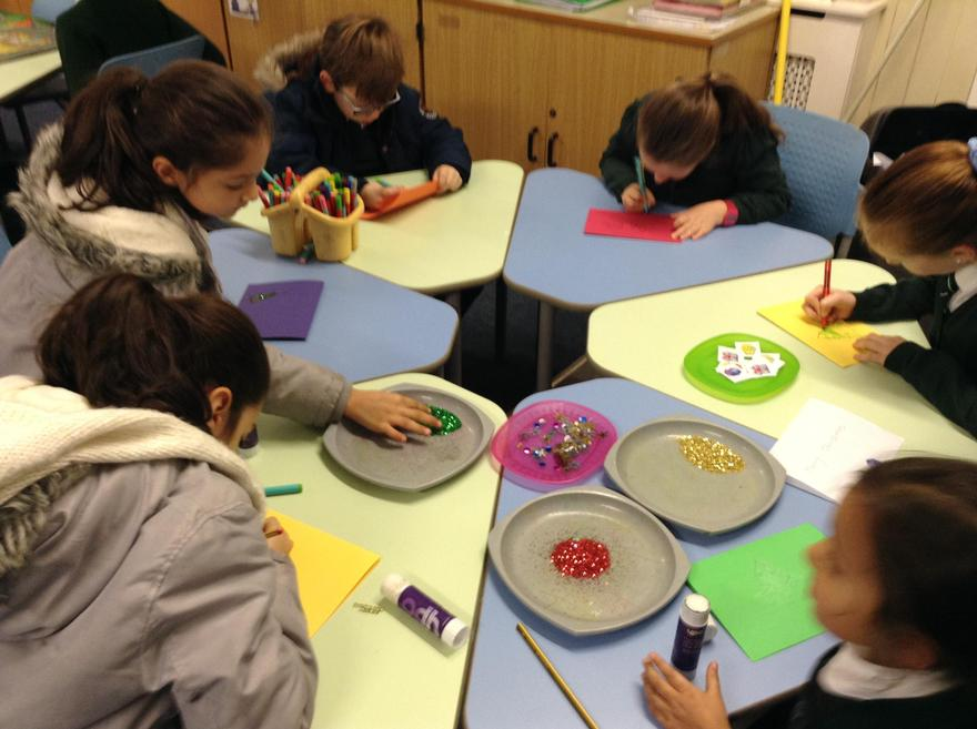 We are busy making christmas cards.