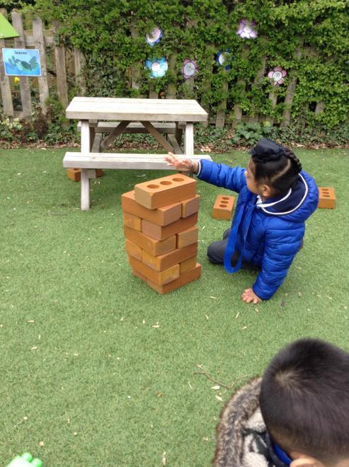 Carefully laying the bricks