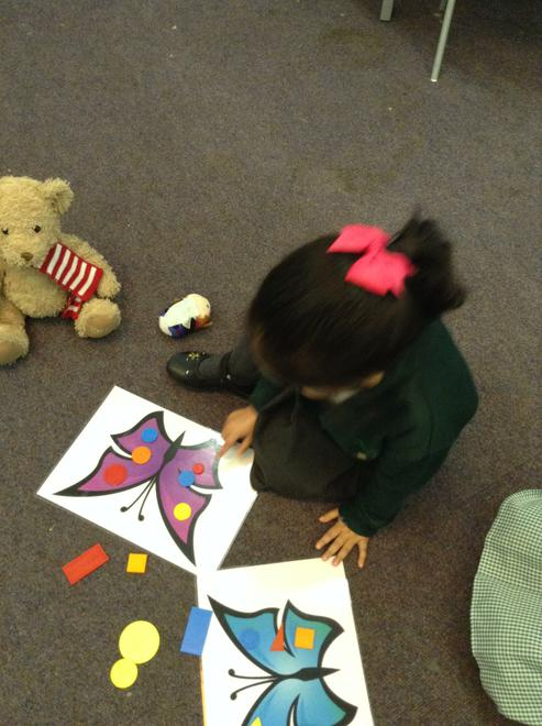 Using 2D shapes to make patterns on the butterfly.