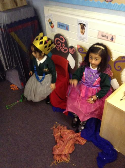 Dressing up as kings and queens in the castle.