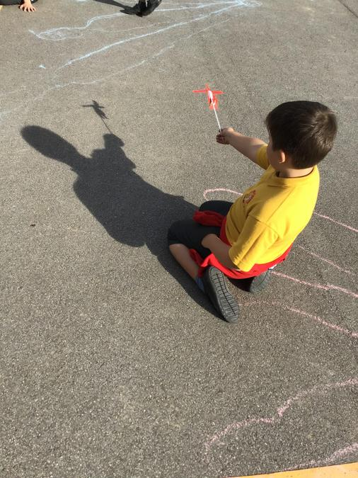 Creating shadow puppets.