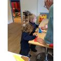 Writing a prayer on a paper aeroplane.