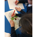 We then decorate skulls with really bright colours