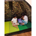 How lovely to have a special tent to read in.