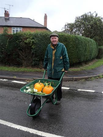 Mr Read helps push the produce home.