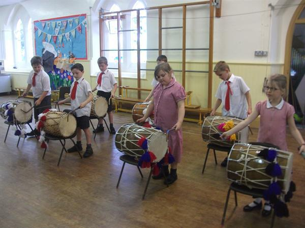 Here we are playing dhol drums.