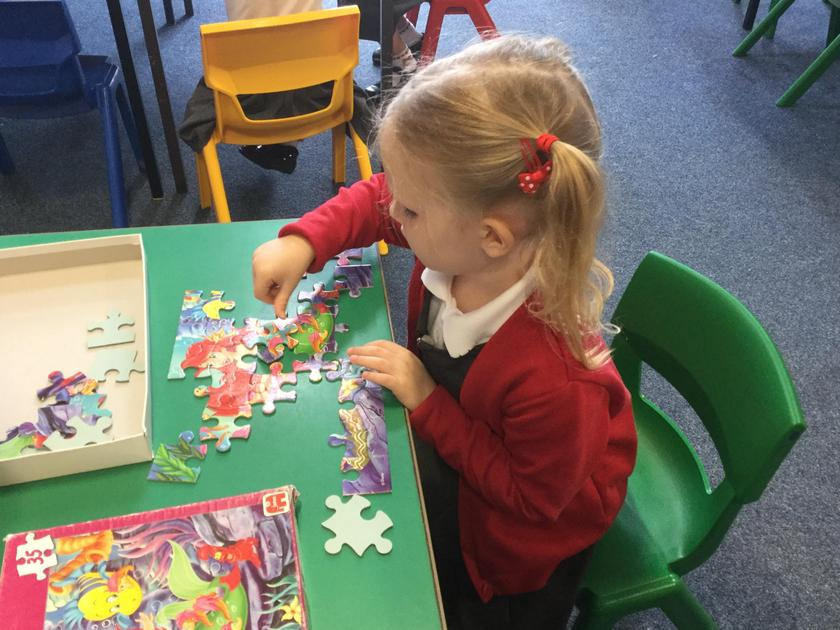 Working hard at a puzzle!