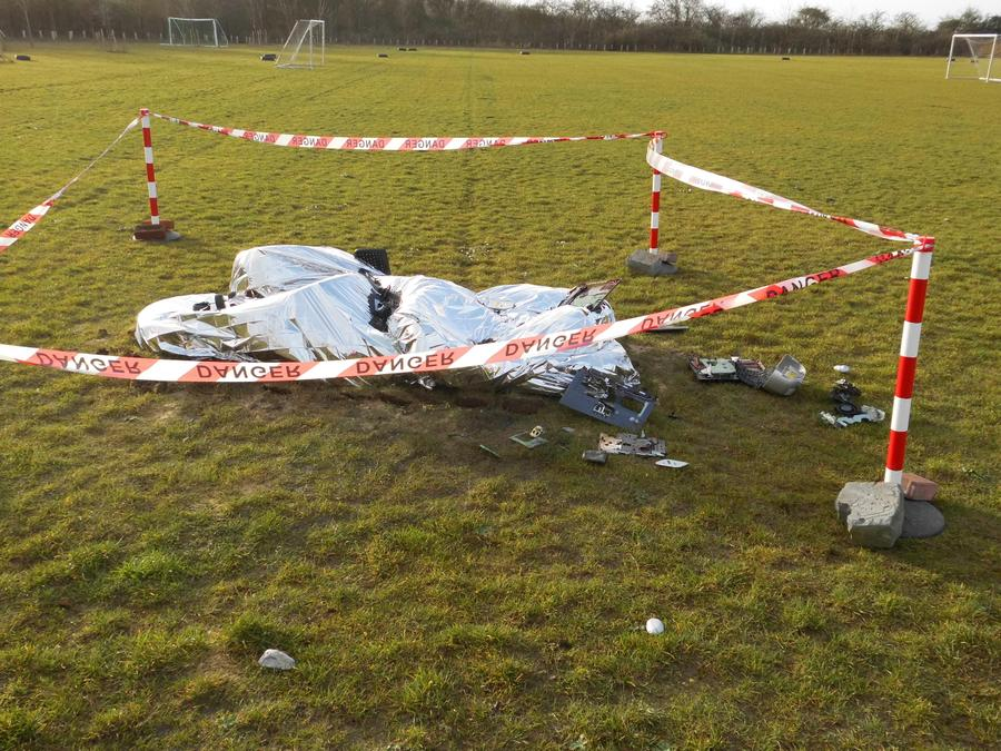 Crash site fenced off with tape that says 'Danger'