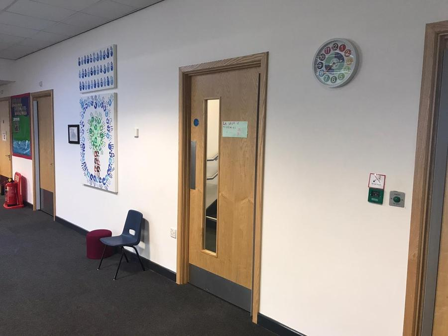 Cambourne corridor with the new clock on display!