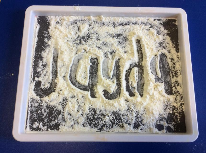 Practising our names in flour