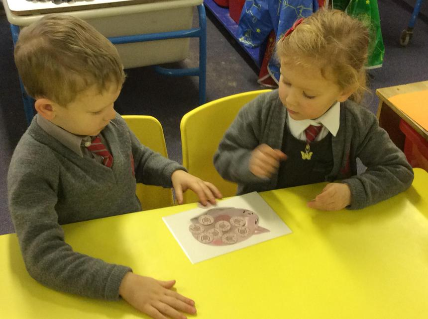 Counting the money in our piggy banks