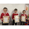 The first three children to achieve 20 houspoints and receive their bronze certificate
