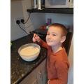 Mixing the pancake batter :)