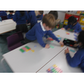 Using Numicon to add numbers to 10 and beyond!!