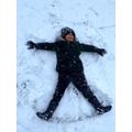 Mrs Ternes' son enjoying making a snow angel