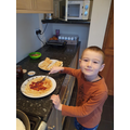 Spreading jam on the pancakes!