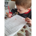 1M Adrian - Busy working hard on my fractions!