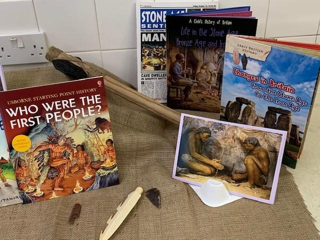Stone Age books and artefacts