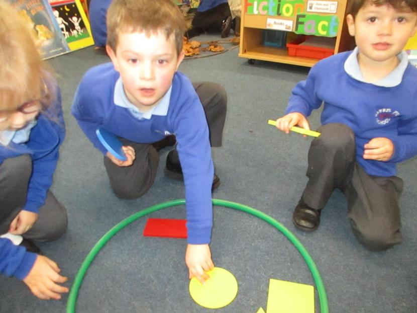 Playing a shape game.