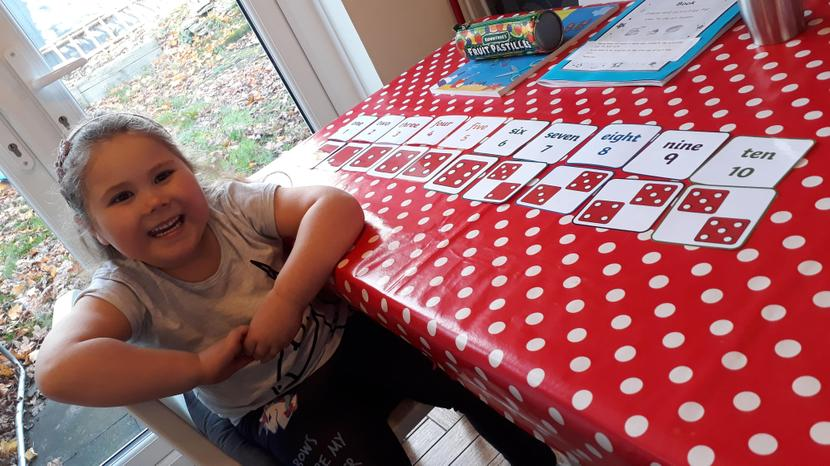 Adelaide playing a math game.