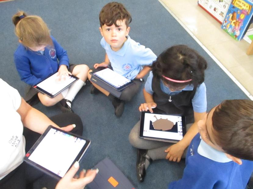 Using the ipads - 2Paint to draw our faces.