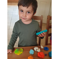 Having fun moulding and playing with playdough