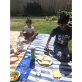 A yummy picnic in the garden with my brother