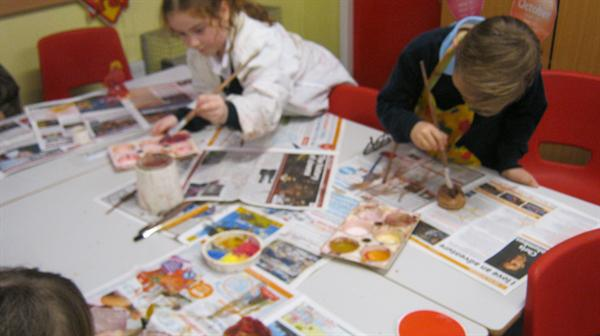 Painting our Stone Age pots.