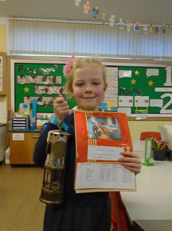 Children bringing in their family artefacts