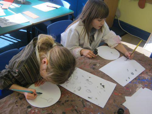 We used ink and quills then watercolours to create