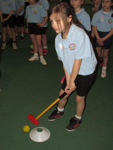Alicia practising her golf action.