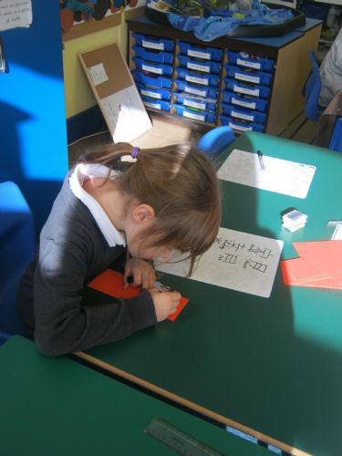 Harriet giving Chinese writing a go!