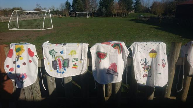 Aprons painted....