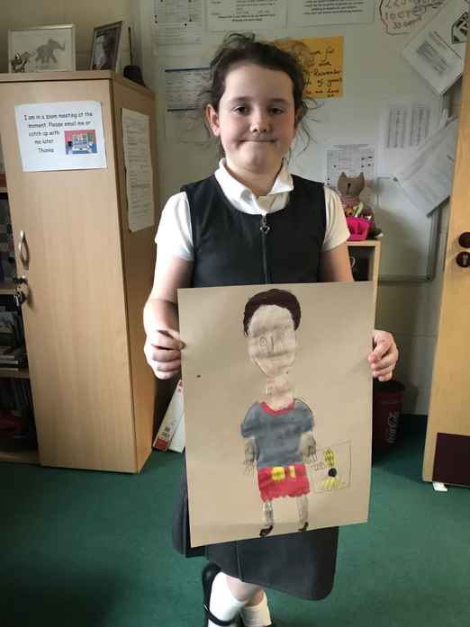 Elsie looking almost pleased with herself and her Roman soldier painting!