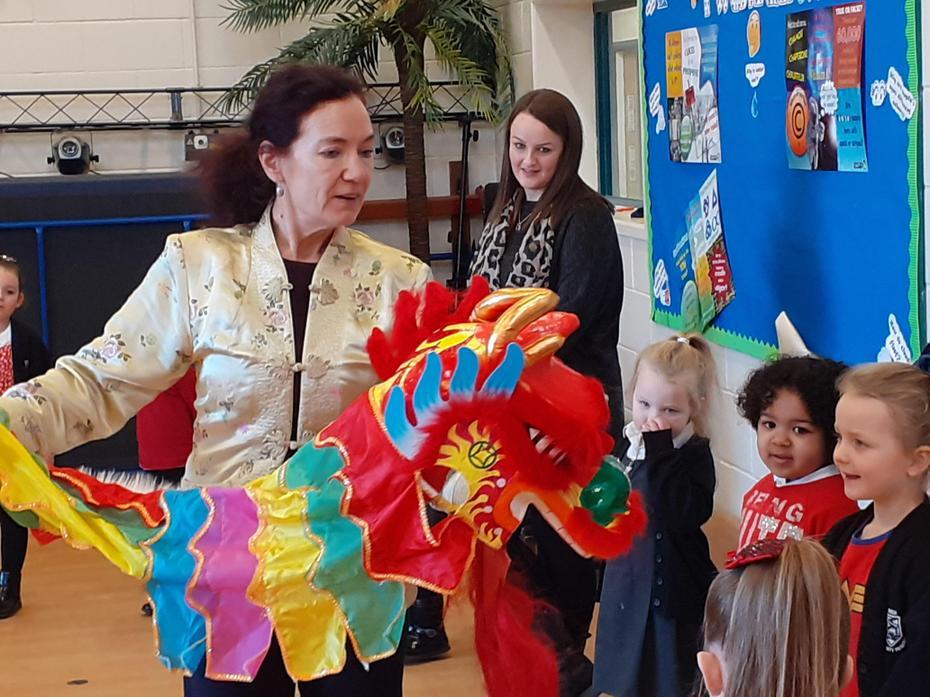 Reception Children Stroke The Dragon Head!