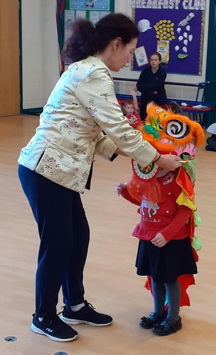 Joanna Fits Dragon Head On Ready For Dancing!