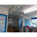 The mobiles are hanging all around the classroom.