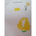 Grace painting daffodils and mixing colours