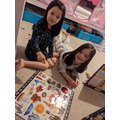Amber completed jig-saws with her sister