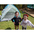 Amber camping in the garden with her sister