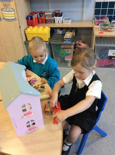 Playing with the doll's house