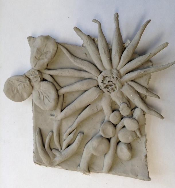 Oliver's clay flower plaque