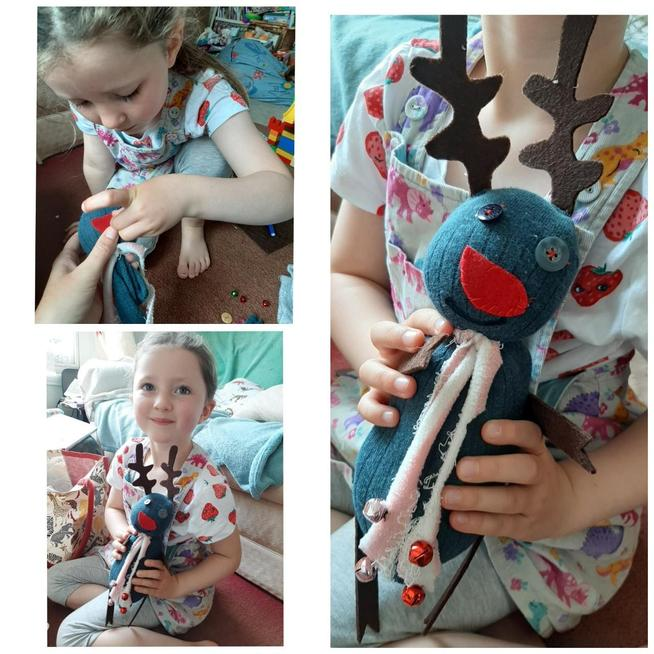Making a reindeer from her old tights