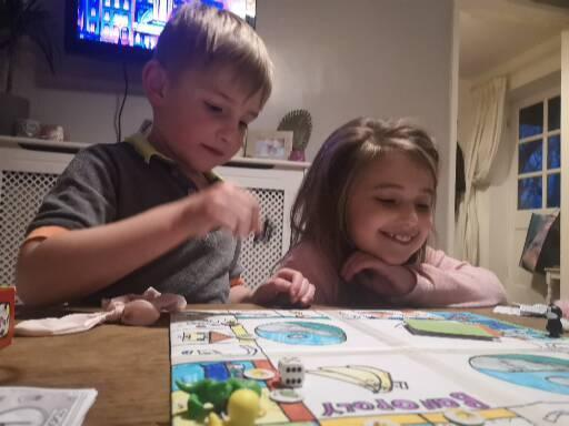 Playing her Banopoly game
