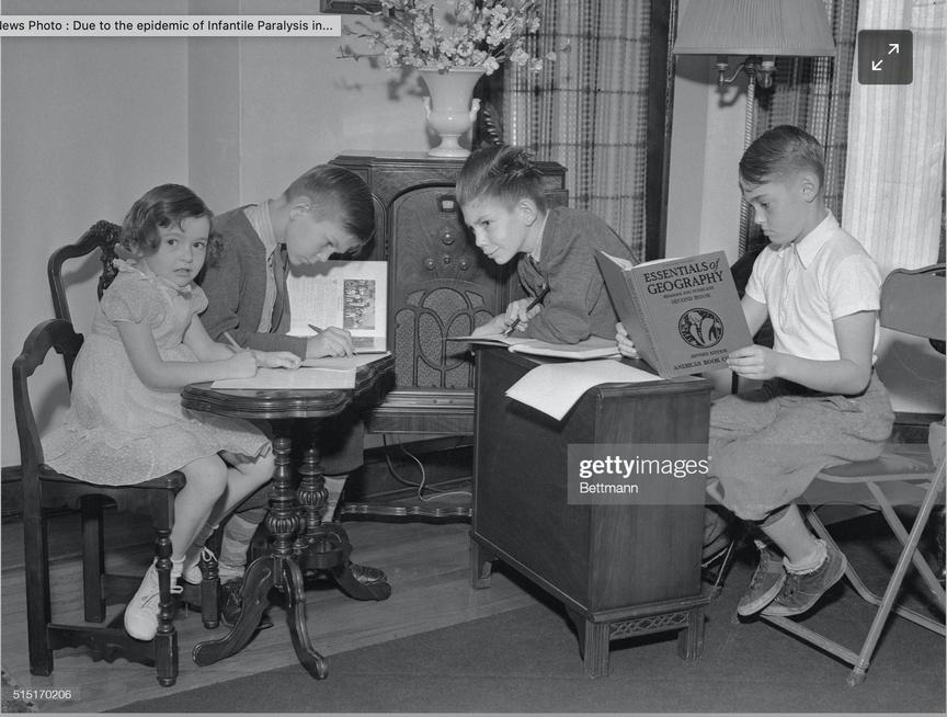 Children doing remote learning listening to the radio in the 1940s during a polio outbreak